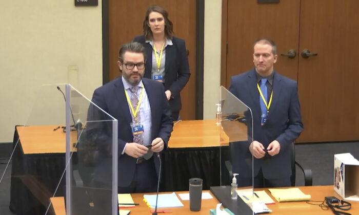 Defense attorney Eric Nelson (L) and defendant former Minneapolis police officer Derek Chauvin (R) and Nelson's assistant Amy Voss (B) introduce themselves to jurors at the Hennepin County Courthouse in Minneapolis, Minn., on March 22, 2021. (Court TV via AP, Pool)