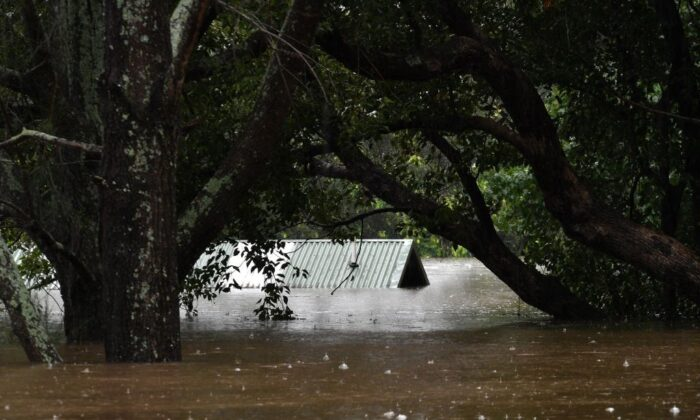 An inundated structure by floodwaters is seen in Richmond, Sydney on March 22, 2021. (Saeed Khan/AFP via Getty Images)