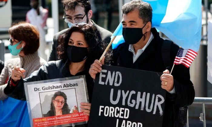 Protesters hold signs as they gather during Uyghur Freedom rally in New York on March 22, 2021. (Timothy A. Clary/AFP via Getty Images)