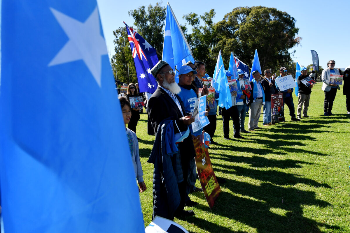Protestors attend a rally for the Uyghur community
