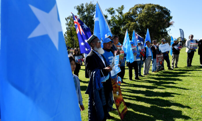 Protestors attend a rally for the Uyghur community at Parliament House in Canberra, Australia on March 15, 2021. (Sam Mooy/Getty Images)