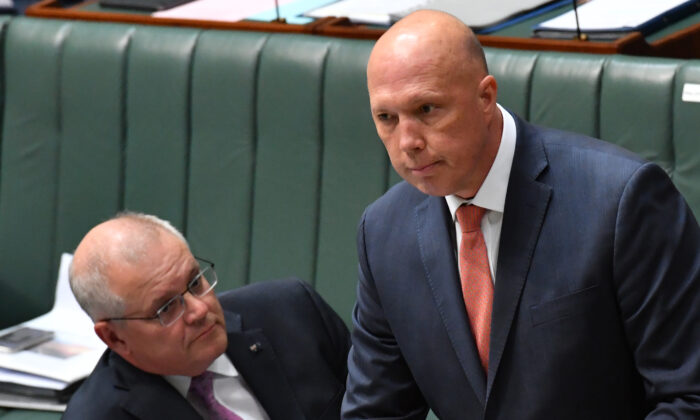 Prime Minister Scott Morrison (L) and Minister for Home Affairs Peter Dutton look on during Question Time in the House of Representatives at Parliament House in Canberra, Australia on March 15, 2021. (Sam Mooy/Getty Images)