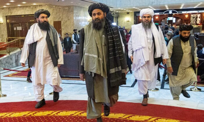 Taliban co-founder Mullah Abdul Ghani Baradar (C) and other members of the Taliban delegation arrive to attend an international conference on Afghanistan over the peaceful solution to the conflict in Moscow on March 18, 2021. (Alexander Zemlianichenko/Pool/AFP via Getty Images)
