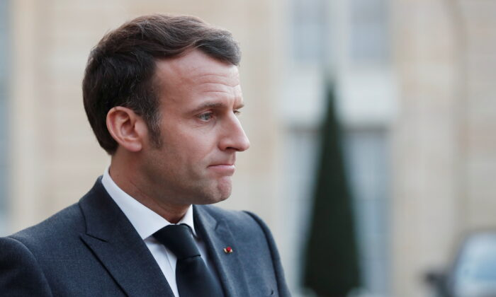 French President Emmanuel Macron, talks to the press after a meeting with Libya's interim leaders at the Elysee Palace in Paris, France, on March 23, 2021. (Benoit Tessier/Reuters)