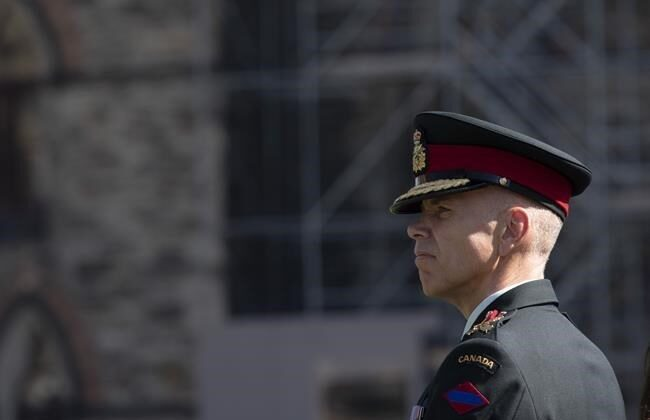 """Lieutenant-General Wayne Eyre listens to speakers during a change of command parade for the Canadian Army on Parliament Hill on August 20, 2019 in Ottawa. Acting chief of the defence staff Lt.-Gen. Eyre says he has asked for military officials to develop a """"play book"""" for handling future misconduct allegations against senior officers. (Adrian Wyld / The Canadian Press)"""