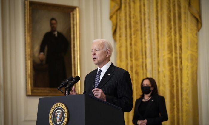 President Joe Biden speaks as Vice President Kamala Harris looks on, in the East Room of the White House in Washington on March 18, 2021. (Drew Angerer/Getty Images)