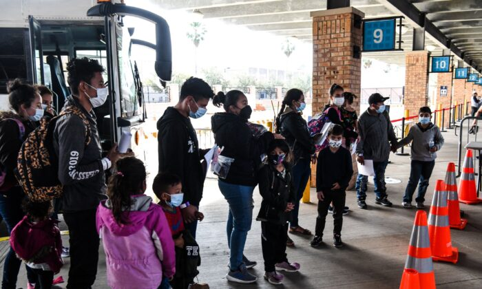 Illegal immigrants, mostly from Central America, are dropped off by Customs and Border Protection at a bus station in the border city of Brownsville, Texas, on March 15, 2021. (Chandan Khanna/AFP via Getty Images)