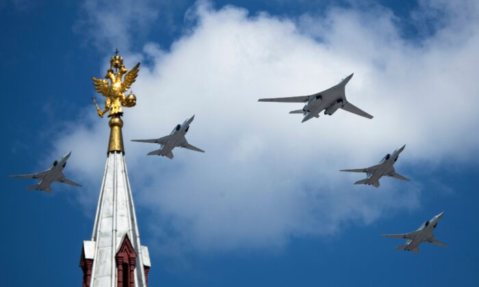 A Tupolev Tu-160 and Tu-22M3 military aircrafts fly over Red Square in Moscow, in a file photo. (Pavel Golovkin/AFP via Getty Images)
