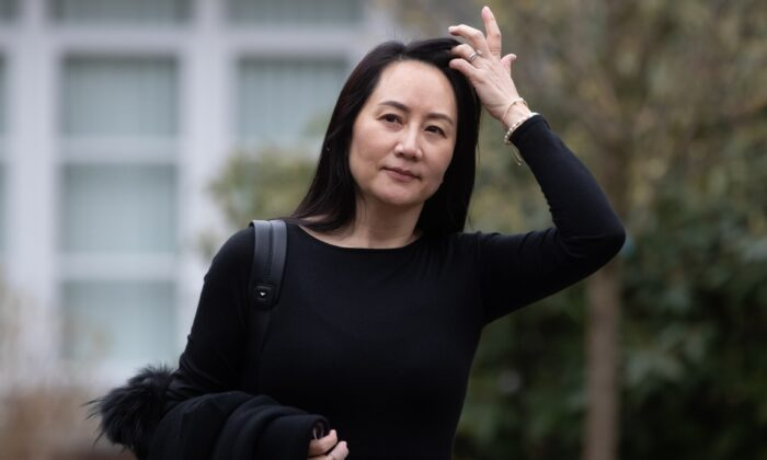 Meng Wanzhou, chief financial officer of Huawei, leaves her home to attend a hearing at B.C. Supreme Court in Vancouver on March 23, 2021. (Darryl Dyck/The Canadian Press)