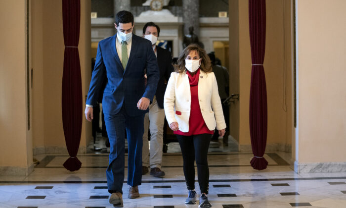 Rep. Lisa McClain (R-Mich.) walks to the House floor at the U.S. Capitol in Washington on Jan. 13, 2021. (Stefani Reynolds/Getty Images)