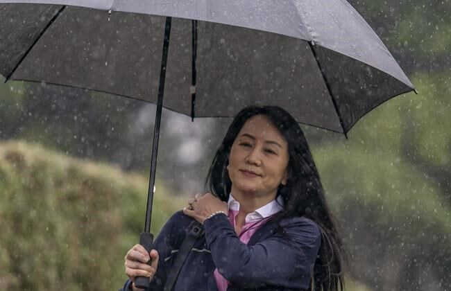 Chief Financial Officer of Huawei, Meng Wanzhou leaves her home in Vancouver, on March 24, 2021 to go to B.C. Supreme Court. (Jonathan Hayward/The Canadian Press)