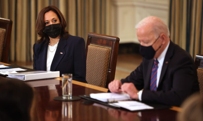 Vice President Kamala Harris (L) and President Joe Biden meet with cabinet members and immigration advisers in the State Dining Room in Washington on March 24, 2021. (Chip Somodevilla/Getty Images)