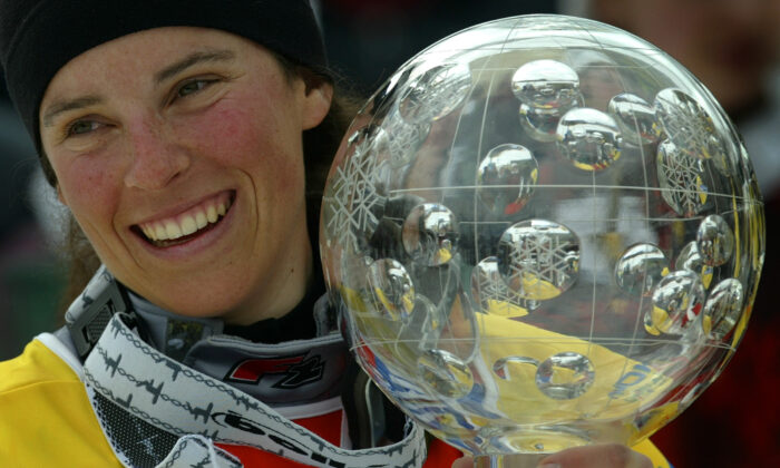 France's Julie Pomagalski smiles as she holds her World Cup trophy at the Alpine skiing World Cup finals in Bardonecchia, Italy, on March 14, 2004. Pomagalski was crowned 2004 World Cup Snowboard winner. (Kieran Doherty/Reuters File Photo