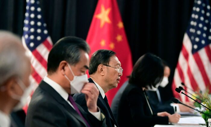 The Chinese delegation led by Yang Jiechi (C), director of the Central Foreign Affairs Commission Office, and Wang Yi (2nd L), China's Foreign Minister, speak with their U.S. counterparts at the opening session of U.S.-China talks at the Captain Cook Hotel in Anchorage, Alaska, on March 18, 2021. (Frederic J. Brown/Pool/AFP via Getty Images)