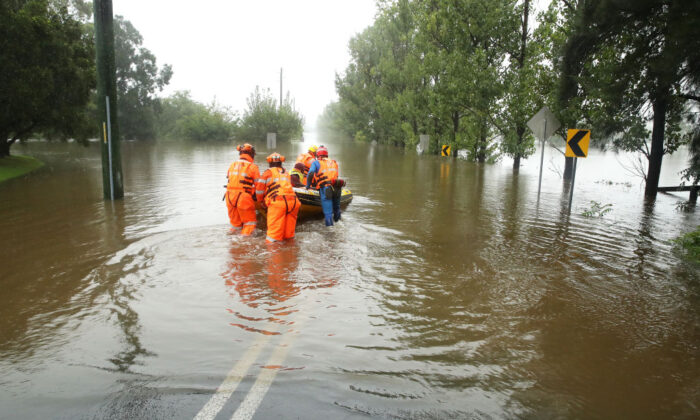 SES workers launch their rescue craft into the flooded Hawkesbury river along Inalls lane in Richmond on March 23, 2021 in Sydney, Australia.  (Mark Kolbe/Getty Images)