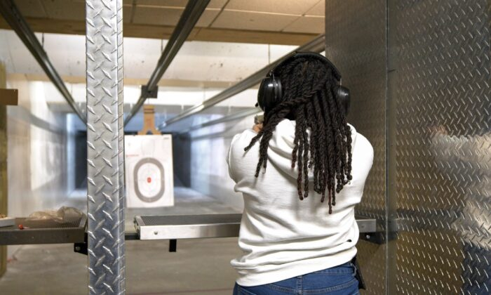 Leonetta Harris, co-founder of Women with Guns and Attitudes, practices shooting at StanMorr Sports in Bridgeview, Ill., on March 2, 2021. (Sam Wang/The Epoch Times)