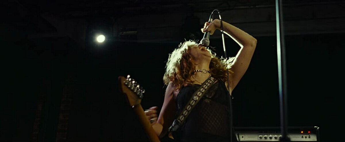 women with guitar and microphone in Sound of Metal