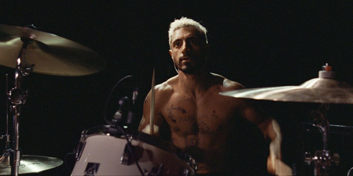 man with no shirt and drum set in Sound of Metal