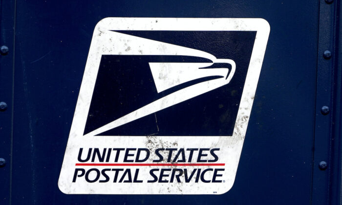 A U.S. Postal Service (USPS) logo is pictured on a mail box in the Manhattan borough of New York City on Aug. 21, 2020. (Carlo Allegri/Reuters)