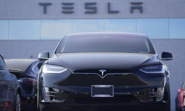 An unsold 2021 Model X sports-utility vehicle sits at a Tesla dealership in Littleton, Colo., on Jan. 24, 2021. (David Zalubowski/AP Photo)