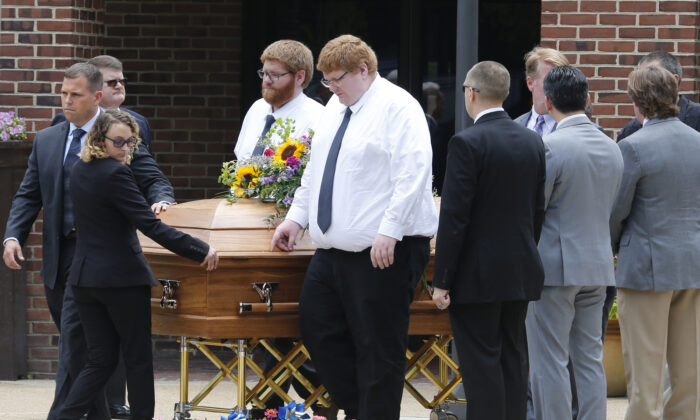 The casket of Virginia Beach shooting victim Katherine Nixon is brought to a hearse after a funeral service at St. Gregory The Great Catholic Church in Virginia Beach, Va. on June 6, 2019. (Steve Helber/AP Photo)