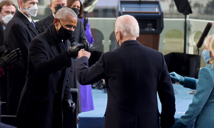 President-elect Joe Biden bumps fists with former President Barack Obama during Biden's inauguration as the 46th President of the United States on the West Front of the U.S. Capitol in Washington on Jan. 20, 2021. (Jonathan Ernst/ReutersPool)