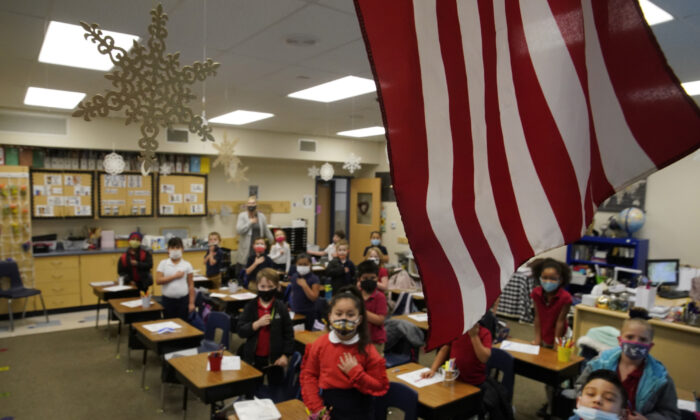 Students recite the Pledge of Allegiance before school at Freedom Preparatory Academy in Provo, Utah, on Feb. 10, 2021.  (Photo by George Frey/Getty Images)