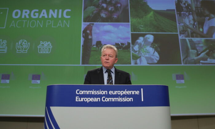 "European Commissioner for Agriculture Janusz Wojciechowski holds a news conference on the EU's action plan ""For the development of organic production: on the way to 2030"", in Brussels, Belgium, on March 25, 2021. (Yves Herman/Pool/Reuters)"