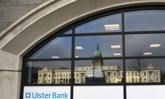 The Customs House is reflected in the window of the Ulster Bank, in Dublin, Ireland, on March 1, 2021. (Clodagh Kilcoyne /Reuters)