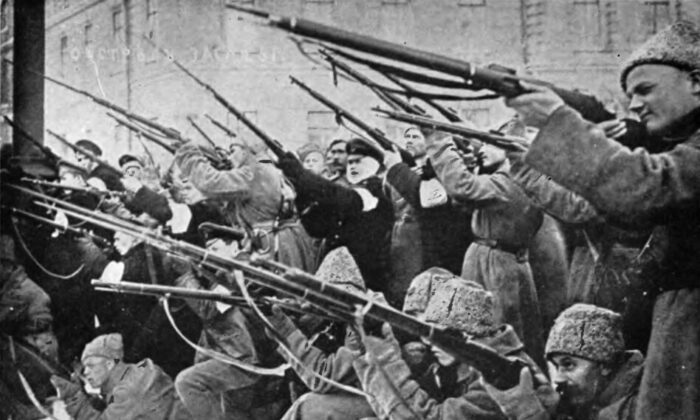 """Bolshevik revolutionaries attacking the czarist police in the early days, 1917, of the Russian Revolution. From Edward Alsworth Ross's """"The Russian Bolshevik Revolution,"""" 1921. (Public Domain)"""