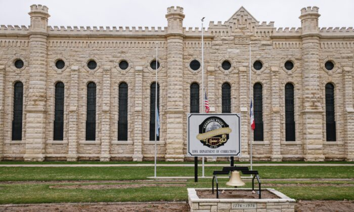 Flags are flown at half staff in memory of the two prison workers killed in an escape attempt at the Anamosa State Penitentiary in Anamosa, Iowa, on March 24, 2021. (Jim Slosiarek/The Gazette via AP)