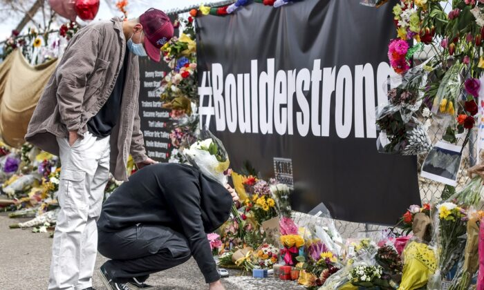 A makeshift memorial outside a King Soopers grocery store where ten people were murdered in Boulder, Col., on March 25, 2021. (Michael Ciaglo/Getty Images)