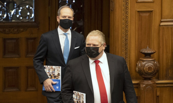 Ontario Finance Minister Peter Bethlenfalvy arrives in the Ontario Legislature with Premier Doug Ford to deliver the Provincial Budget on March 24, 2021. (Frank Gunn/The Canadian Press)