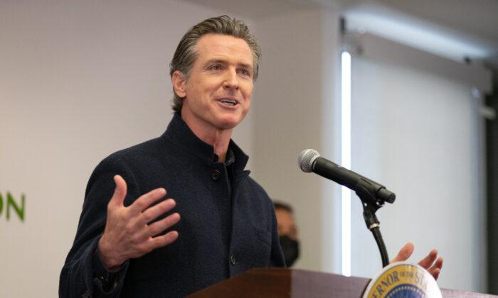 Gov. Gavin Newsom speaks to reporters at AltaMed Urgent Care in Santa Ana, Calif., on March 25, 2021. (John Fredricks/The Epoch Times)