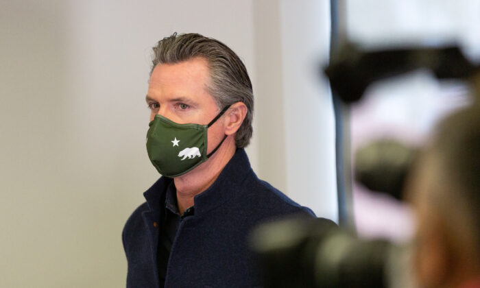 Gov. Gavin Newsom attends a press conference at AltaMed Urgent Care in Santa Ana, Calif., on March 25, 2021. (John Fredricks/The Epoch Times)