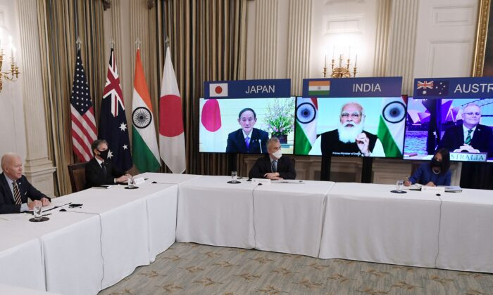 "President Joe Biden (L), with Secretary of State Antony Blinken (2nd L), meets virtually with members of the ""Quad"" alliance of Australia, India, Japan, and the United States, in the State Dining Room of the White House in Washington on March 12, 2021.  (Olivier Douliery/AFP via Getty Images)"