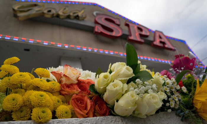 Flowers adorn Gold Spa during a demonstration against violence following the March 16 shooting in which three women were killed in Atlanta on March 18, 2021. (Megan Varner/Getty Images)