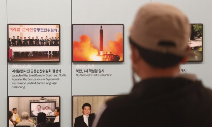 A photo showing North Korea's missile launch is displayed at the Unification Observation Post in Paju, near the border with North Korea, South Korea, Wednesday, March 24, 2021 (AP Photo/Ahn Young-joon)
