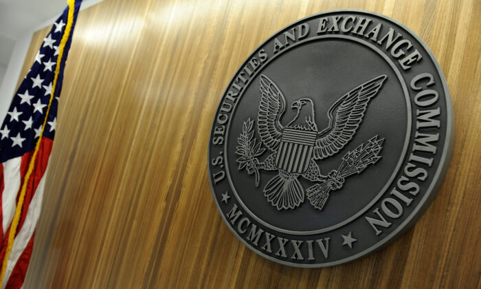 The seal of the U.S. Securities and Exchange Commission hangs on the wall at SEC headquarters in Washington, on June 24, 2011.