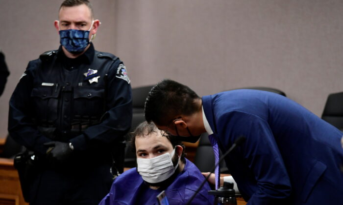 King Soopers shooting suspect Ahmad Al Aliwi Alissa, 21, appears before Boulder District Court Judge Thomas Mulvahill at the Boulder County Justice Center in Boulder, Colo., on March 25, 2021. (Helen H. Richardson/The Denver Post/Pool via Reuters)