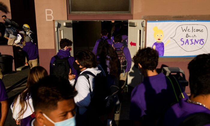 Students return to in-person learning at St. Anthony Catholic High School in Long Beach, Calif., on March 24, 2021. (Patrick T. Fallon/AFP via Getty Images)