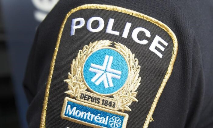 A Montreal police patch is seen on an officer during a news conference in Montreal, on March 25, 2021. (Ryan Remiorz/The Canadian Press)