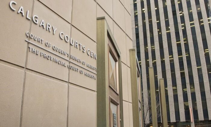 The Calgary Courts Centre in Calgary, Alta., on March 11, 2019. The sister of a Calgary caseworker who was stabbed to death at an assisted-living home last month said Monday she lost her soulmate and doesn't want any other family to suffer the way hers has. Nancy Euwangue, who flew in from London, took in a court appearance for Brandon Newman, 18, who was charged with second-degree murder after the Oct. 25 death of Deborah Onwu. (Jeff McIntosh/The Canadian Press)