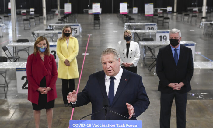 Ontario Premier Doug Ford answers questions from the media at a mass COVID-19 vaccination clinic in Toronto on March 10, 2021. (Nathan Denette/The Canadian Press)