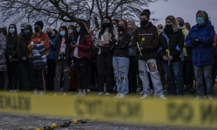 Mourners attend a vigil for the victims of a mass shooting at a King Soopers grocery store in Boulder, Col., on March 25, 2021. The Monday shooting left ten people dead, including one police officer. (Chet Strange/Getty Images)
