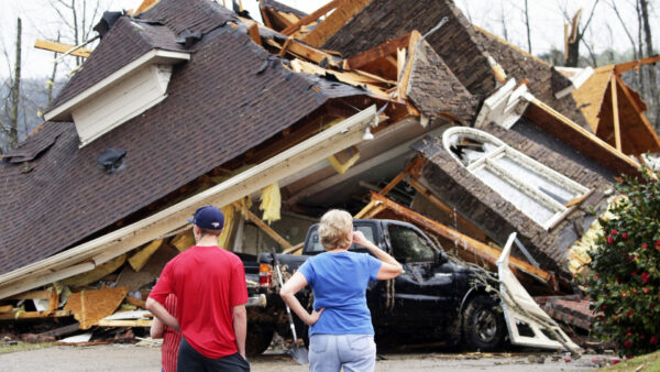 Residents survey damage to homes