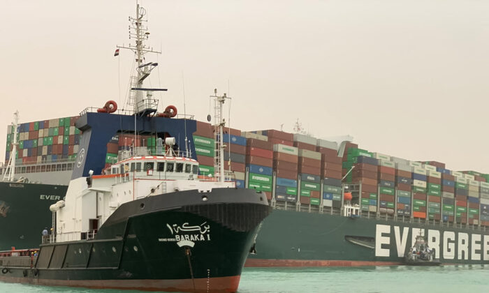 A part of the Taiwan-owned MV Ever Given (Evergreen), a 400-metre- (1,300-foot-) long and 59-metre wide vessel, lodged sideways and impeding all traffic across the waterway of Egypt's Suez Canal on March 24, 2021. (Suez Canal Authority/Handout/AFP via Getty Images)