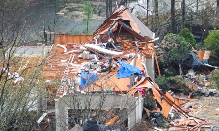 A house is left missing a roof after a tornado passed through the Eagle Point subdivision in Hoover, Ala., on March 25, 2021.  (Marvin Gentry/REUTERS)