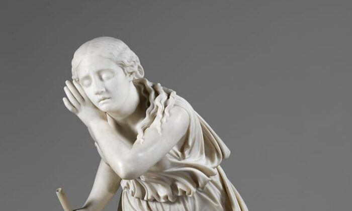 """A detail from """"Nydia, the Blind Flower Girl of Pompeii,"""" 1853--54, by Randolph Rogers. Carrara marble; 36 1⁄8 inches by 17 1⁄4 inches by 25 1⁄4 inches. Metropolitan Museum of Art, New York. (Public Domain)"""