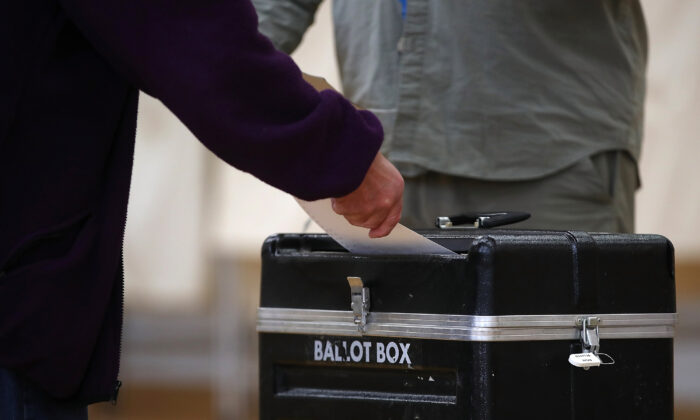 A voter casts his ballot in a polling station in Missoula, Mont., in a file photo. (Justin Sullivan/Getty Images)
